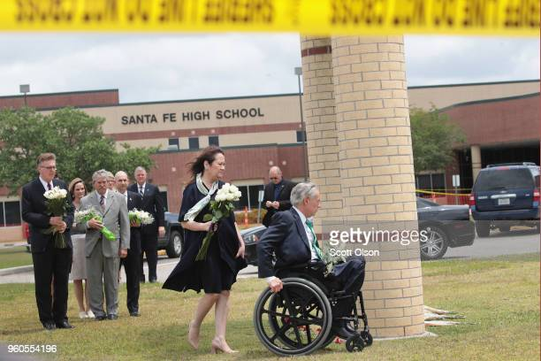 Texas Governor Greg Abbott visits Santa Fe High School with his wife Cecilia to lay flowers at a small memorial on May 20 2018 in Santa Fe Texas Last...