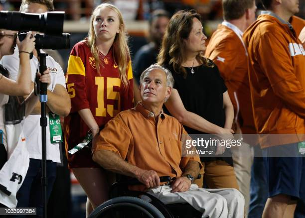Texas Governor Greg Abbott watches from the sideline in the second half of the game between the Texas Longhorns and the USC Trojans at Darrell K...