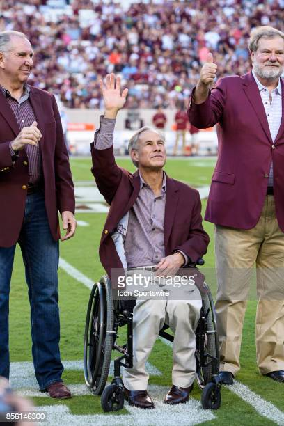 Texas Governor Greg Abbott waves to the crowd before the start of the the college football game between the South Carolina Gamecocks and the Texas AM...