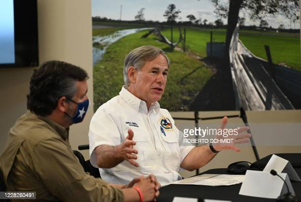 Texas Governor Greg Abbott , with US Senator Ted Cruz , attends a briefing for US President Donald Trump in Orange, Texas, on August 29, 2020. Trump...