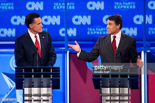 Texas Governor Rick Perry and former Massachusetts Governor Mitt Romney during the CNN Tea Party Republican presidential debate in Tampa Florida