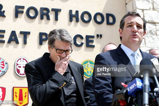 Texas Governor Rick Perry and Sen Ted Cruz during a press conference held at the front gate to Fort Hood about Iraq war veteran Ivan Lopez who killed...
