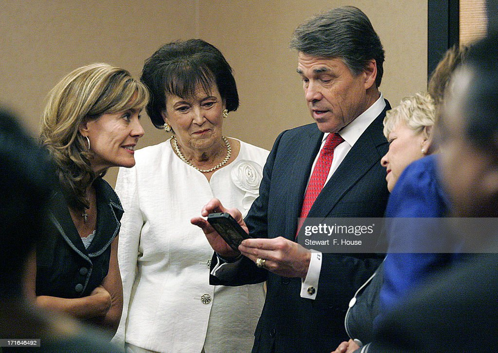 Texas Governor Rick Perry (2nd R) shares information with Elizabeth Graham (L), director of Texas Right to Life, Ann Hettinger (2nd L), with Concerned Women for America, and Carrol Everett (R), with the Heidi Group, in a corridor National Right to Life Committee during their opening general session at the Hyatt Regency DFW International Airport Hotel June 27, 2013 in Grapevine, Texas. Perry has reportedly vowed to continue the fight for a more restrictive abortion law in Texas after the state legislature failed to get the law passed during a special session because of a filibuster and protests.