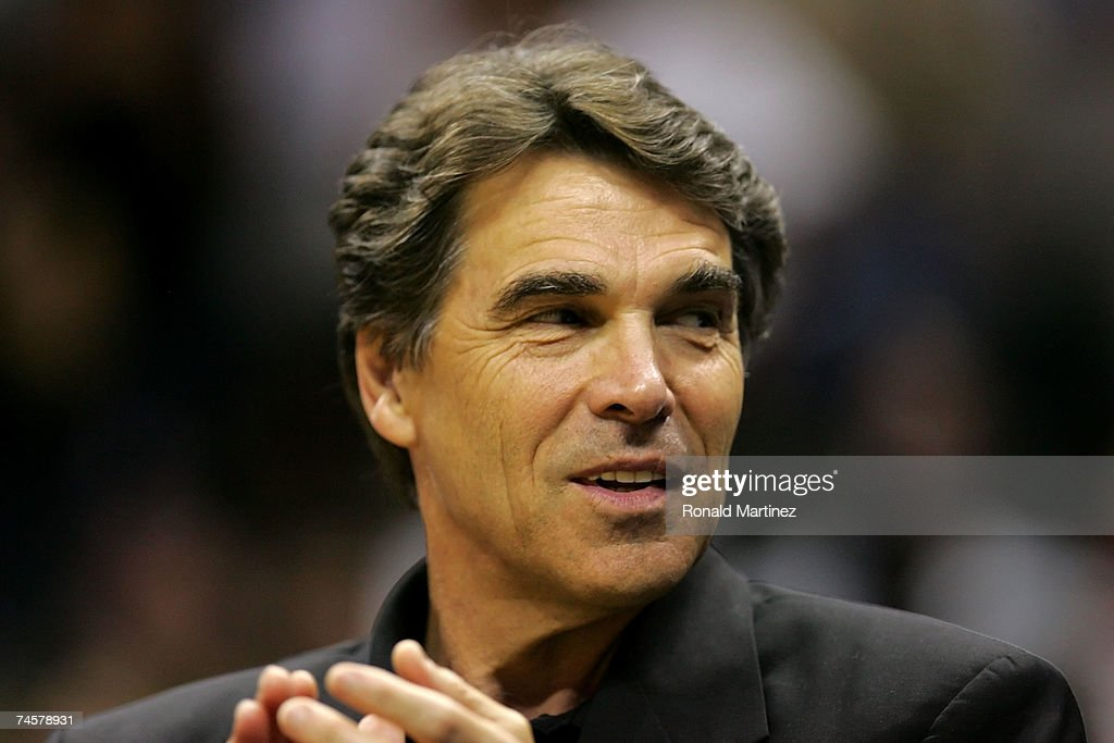 Texas Governor Rick Perry watches the action in Game Two of the 2007 NBA Finals between the Cleveland Cavaliers and San Antonio Spurs on June 10, 2007 at the AT&T Center in San Antonio, Texas.