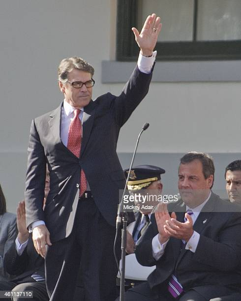 Texas Governor Rick Perry waves to attendees at the inauguration of Florida Governor Rick Scott