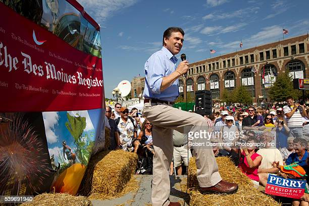 Texas Governor Rick Perry works the crowd at the Iowa State Fair on Monday morning eating a veggie dog and speaking at the soapbox
