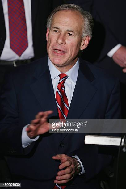 Texas Governorelect Greg Abbott talks with reporters outside the White House after meeting with US President Barack Obama December 5 2014 in...