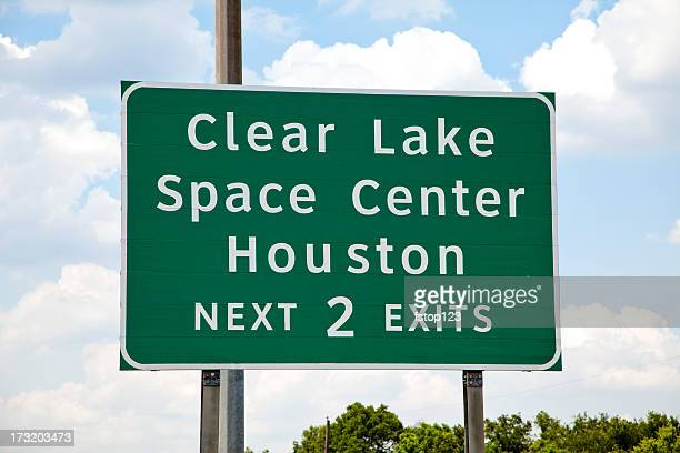 Texas highway sign showing exit Space Center Houston.