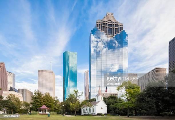 USA, Texas, Houston, Sam Houston Park, St. Johns Church and skyline