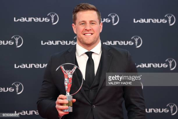 US Texas Houston's defensive end Justin James Watt poses with his Laureus inspiration award trophy during the 2018 Laureus World Sports Awards...