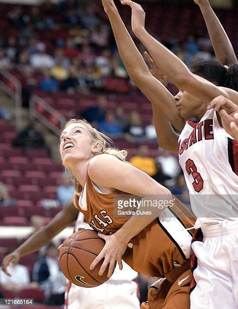 Texas Kala Bowers 4 looks for a route to the basket under the guard of Keisha Brown 3 in Texas game with NC State in the Jimmy V Classic