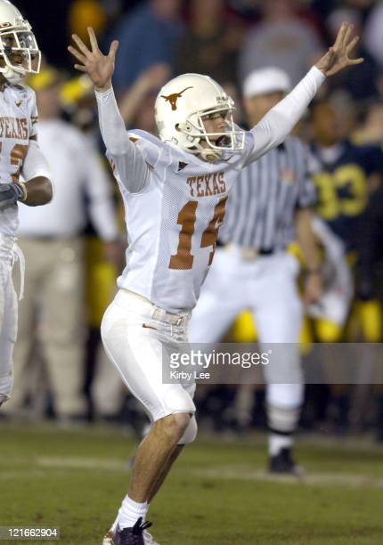 Texas kicker Dusty Mangum celebrates after kicking a 37yard field goal for the winning points in 3837 victory over Michigan in the 91st Rose Bowl in...