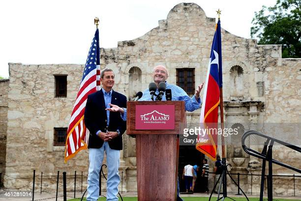 Texas Land Commissioner Jerry Patterson listens as Phil Collins speaks in front of The Alamo announcing the donation of his collection of historical...