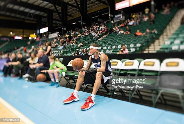 Texas Legends basketball player Delonte West breaks from his workout routine on the court to watch a pregame dance routine performed by local...