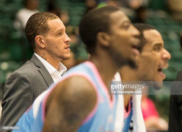 Texas Legends basketball player Delonte West stands with his teammates on the bench at the Dr Pepper Arena on April 1 2015 in Frisco Texas The Texas...