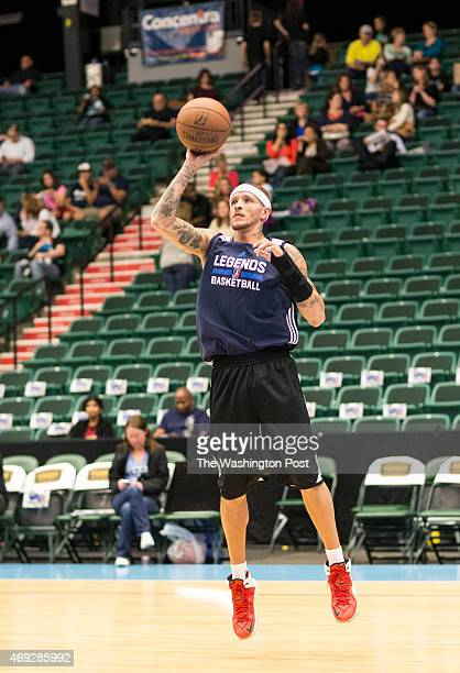 Texas Legends basketball player Delonte West takes a shot at the basket with his nondominant hand during a solo pregame workout at the Dr Pepper...