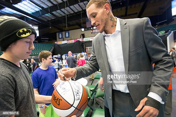 Texas Legends basketball player Delonte West takes time at the end of the game to sign autographs for fans at the Dr Pepper Arena on April 1 2015 in...