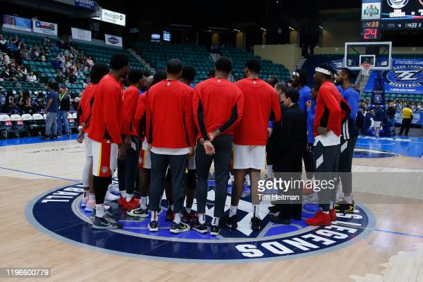 Texas Legends players and College Park Skyhawks players meet at center court before the game to learn about the death of Kobe Bryant on January 26,...