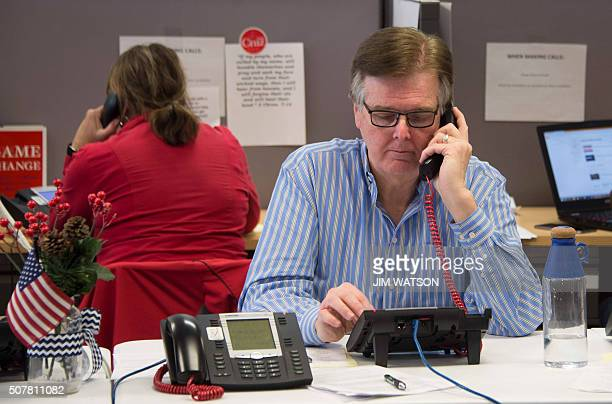 Texas Lieutenant Governor Dan Patrick makes phone calls as a volunteer for Republican presidential candidate Ted Cruz at his headquarters in West Des...