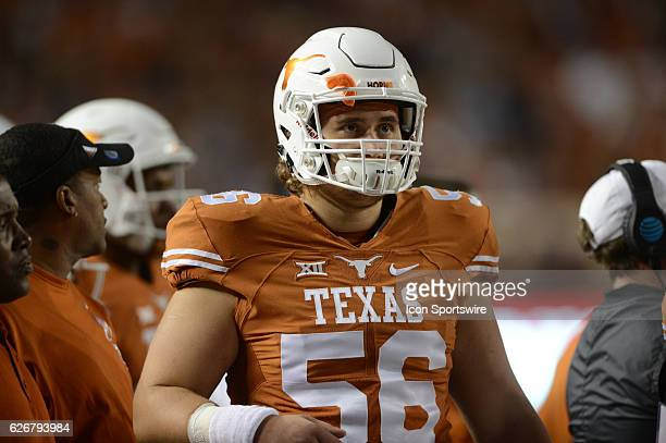 Texas Longhorn center Zach Shackelford watches a replay on the jumbotron during NCAA game featuring the Texas Longhorns and the TCU Horned Frogs on...