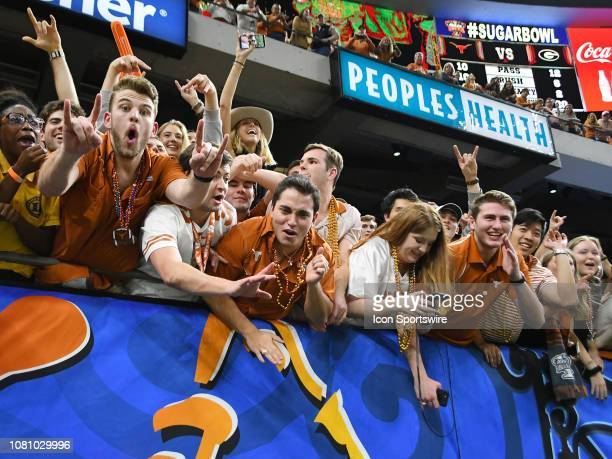 Texas Longhorn fans celebrate after the Allstate Sugar Bowl between the Texas Longhorns and the Georgia Bulldogs on January 01 at the MercedesBenz...