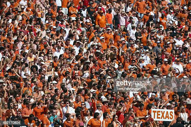 Texas Longhorn fans cheer as the Longhorns take on the Oklahoma Sooners in the fourth quarter during the ATT Red River Showdown at the Cotton Bowl on...