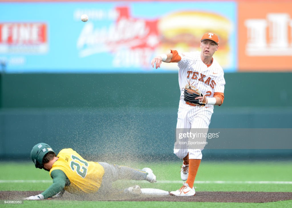 Texas Longhorn infielder Kody Clemens turns a double play as Baylor Bear Richard Cunningham slides during the Texas Longhorns 4 - 1 win over the Baylor Bears on April 8, 2018 at UFCU Disch-Falk Field in Austin, TX.