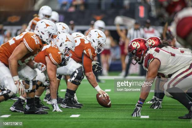 Texas Longhorns and Oklahoma Sooners square off at the line of scrimmage during the Big 12 Championship Game between Oklahoma and Texas on December...