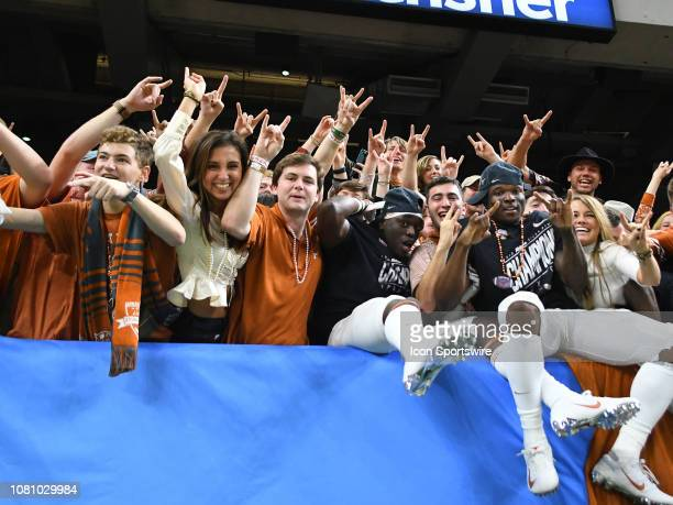 Texas Longhorns celebrate with fans after the Allstate Sugar Bowl between the Texas Longhorns and the Georgia Bulldogs on January 01 at the...