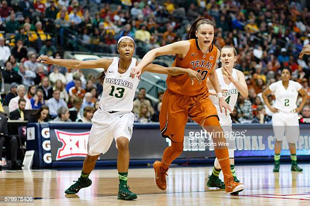 Texas Longhorns center Kelsey Lang and Baylor Bears forward Nina Davis battle for position during the NCAA Big 12 Women's basketball championship...