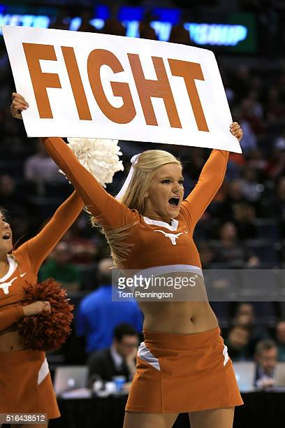 Texas Longhorns cheerleader hold a sign that reads FIGHT in the game between the Northern Iowa Panthers and the Texas Longhorns during the first...