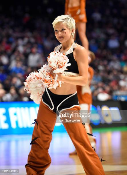 Texas Longhorns cheerleader performs during a time out during the NCAA Division I Men's Championship First Round game between the Nevada Wolf Pack on...