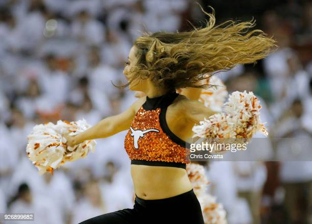 Texas Longhorns cheerleader performs during the game against the Oklahoma State Cowboys at the Frank Erwin Center on February 24 2018 in Austin Texas
