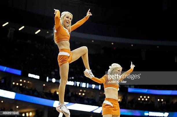 Texas Longhorns cheerleader performs in the first half against the Butler Bulldogs during the second round of the 2015 NCAA Men's Basketball...
