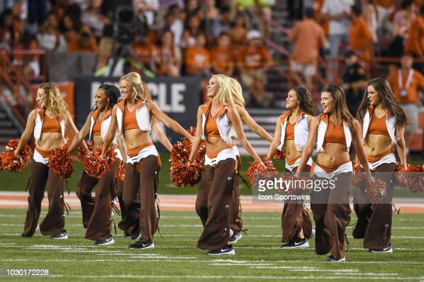 Texas Longhorns cheerleaders perform during the game between the Tulsa Golden Hurricane and the Texas Longhorns on September 8 at Darrell K...