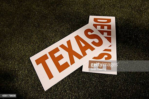 Texas Longhorns cheerleaders' signs on the ground during the game against the Oklahoma State Cowboys November 15 2014 at Boone Pickens Stadium in...