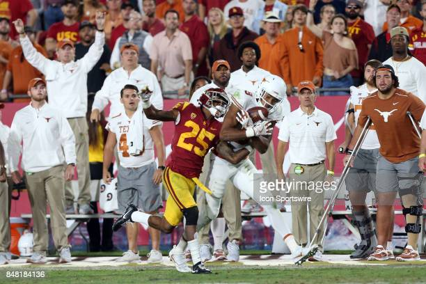 Texas Longhorns Collin Johnson makes a catch over USC Trojans Jack Jones during the game on September 16 at the Los Angeles Memorial Coliseum in Los...