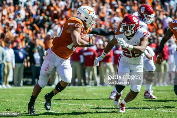 Texas Longhorns defensive back Brandon Jones returns a pass intercepted in the end zone during a game between the Texas Longhorns and the Oklahoma...