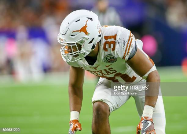 Texas Longhorns defensive back Jason Hall sets up at the line of scrimmage during the Texas Bowl game between the Texas Longhorns and Missouri Tigers...