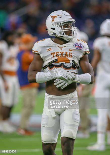 Texas Longhorns defensive back Kris Boyd warms up during the Texas Bowl game between the Texas Longhorns and Missouri Tigers on December 27 2017 at...