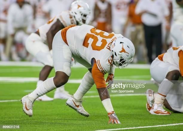 Texas Longhorns defensive end Malcolm Roach sets up at the line of scrimmage during the Texas Bowl game between the Texas Longhorns and Missouri...