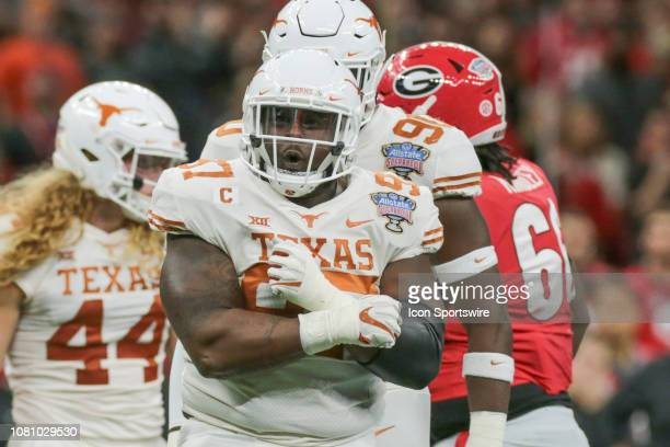 Texas Longhorns defensive lineman Chris Nelson celebrates a tackle in the backfield during the Allstate Sugar Bowl game between the Georgia Bulldogs...