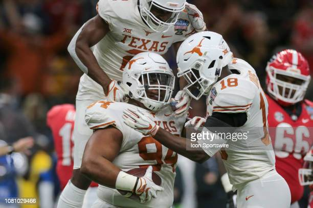 Texas Longhorns defensive lineman Gerald Wilbon celebrates a fumble recovery during the Allstate Sugar Bowl game between the Georgia Bulldogs and the...