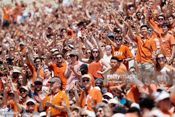 Texas Longhorns fans celebrate the start of the fourth quarter against the Maryland Terrapins at Darrell K RoyalTexas Memorial Stadium on September 2...