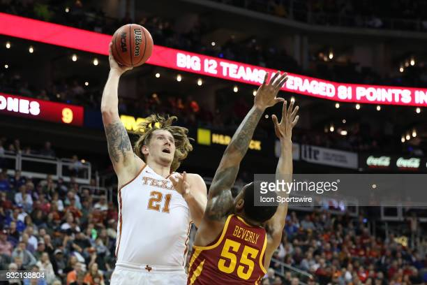 Texas Longhorns forward Dylan Osetkowski shoots a baby hook over Iowa State Cyclones forward Jeff Beverly in the first half of a first round matchup...