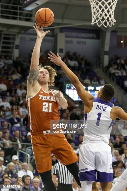 Texas Longhorns forward Dylan Osetkowski shoots with TCU Horned Frogs guard Desmond Bane defending during the game between the Texas Longhorns and...