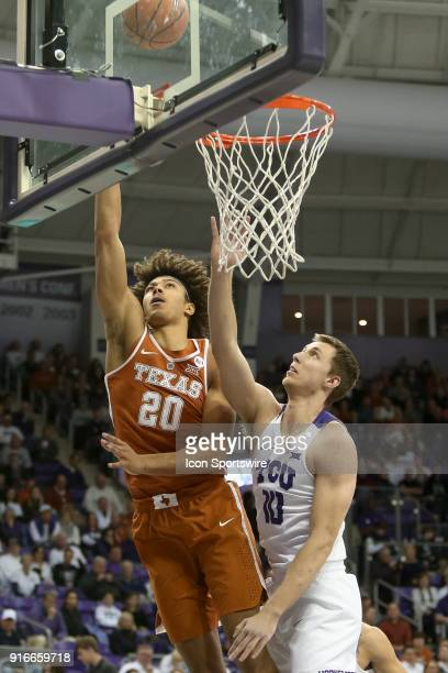 Texas Longhorns forward Jericho Sims lays the ball in with TCU Horned Frogs forward Vladimir Brodziansky defending during the game between the Texas...