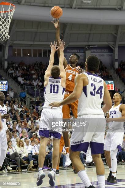 Texas Longhorns forward Mohamed Bamba lofts a shot over TCU Horned Frogs forward Vladimir Brodziansky during the game between the Texas Longhorns and...