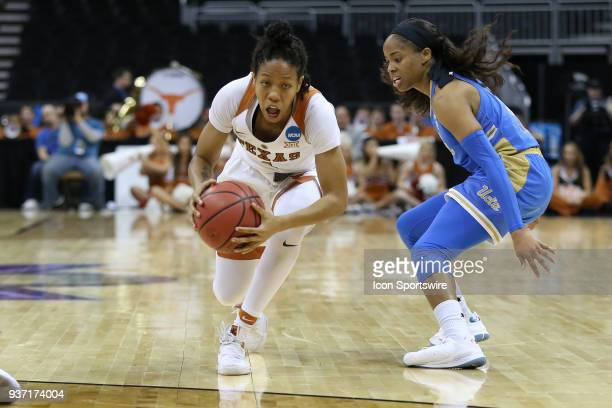 Texas Longhorns guard Alecia Sutton loses her balance as she goes past UCLA Bruins guard Jordin Canada in the second quarter of a third round NCAA...