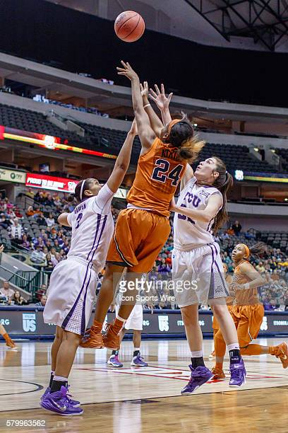 Texas Longhorns guard Ariel Atkins is fouled by TCU Horned Frogs guard/forward Veja Hamilton during the NCAA Big 12 Women's basketball tournament...